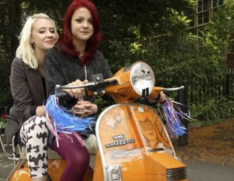 Lily Loveless and Kathryn Prescott as Naomi and Emily in