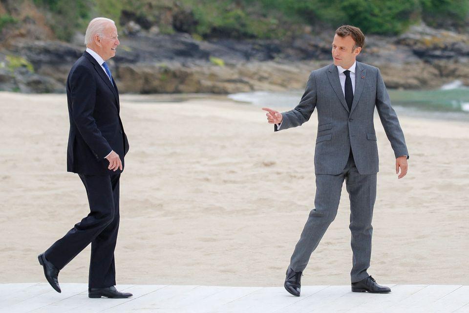 French president Emmanuel Macron (right) greets US president Joe Biden at the G7
