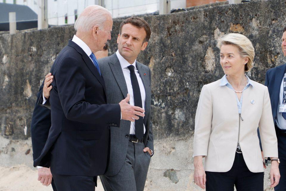 Macron was flanked by European Commission president Ursula von der
