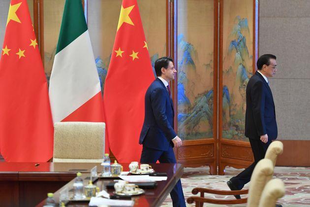 BEIJING, CHINA - APRIL 28: Italian Prime Minister Giuseppe Conte, left, walks with Chinese Premier Li...
