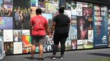 ORLANDO, FL - JUNE 12: Karen Striplin (L) and Bianca Booker spend time at the memorial set up for the shooting victims at Pulse nightclub where the shootings took place two years ago on June 12, 2018 in Orlando, Florida. On June 12, 2016 a mass shooting took place at Pulse nightclub killing 49 people and wounding 53 in one of the worst mass shootings in U.S. history.  (Photo by Joe Raedle/Getty Images)