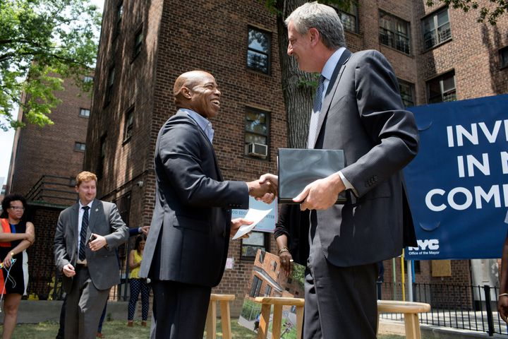 Some progressives see Adams' ties to Mayor Bill de Blasio, right, as a selling point. Others see it as a sign that he would h
