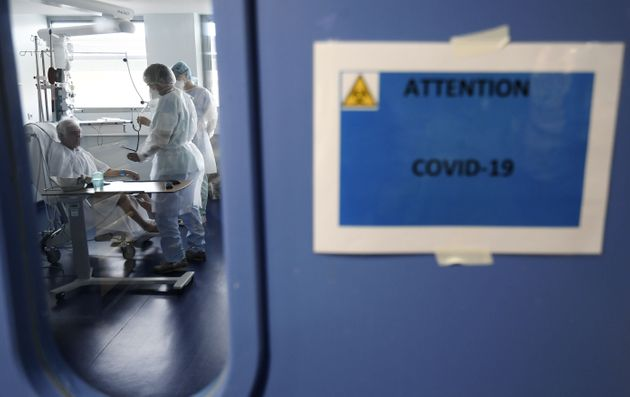 Medical staff tend to a patient in an intensive care unit for patients infected with Covid-19 (novel...
