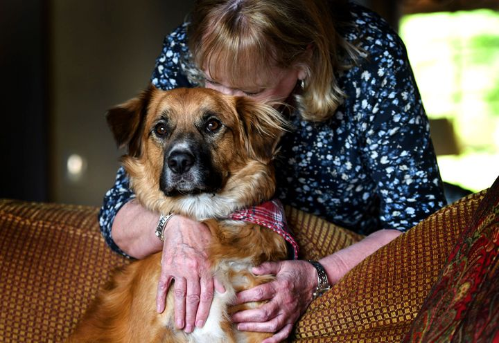 Linda Oswald hugs 2-year-old dog Tilly at their home in Hayden, Idaho on Tuesday, June 8, 2021. (Kathy Plonka/The Spokesman-R