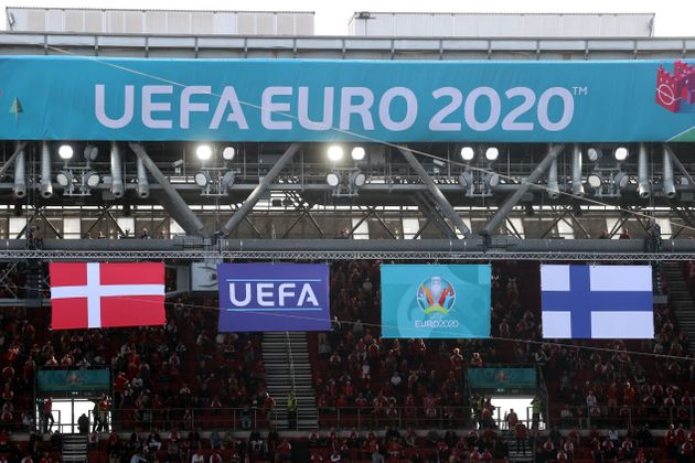 Denmark's and Finland's (R) flags flutter during the UEFA EURO 2020 Group B football match between Denmark...