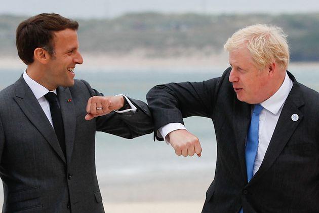 Boris Johnson greets French president Emmanuel Macron at the G7 summit on Friday