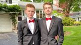 The author's sons, Jonah (right) and Ian (left), poses for prom pictures on their front lawn.