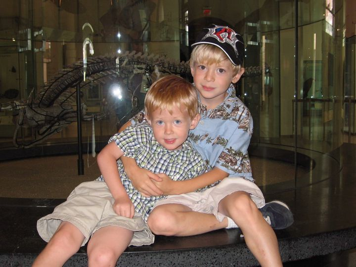 Jonah (right), age 6, looks after his then-3-year old brother, Ian (left), on a trip to the Museum of Natural History in New