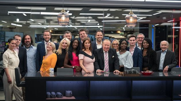 Andrew Neil posing with the on-air GB News team after its launch