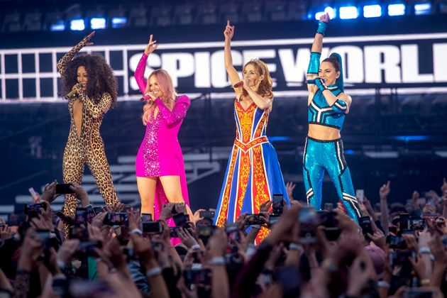 The Spice Girls – minus Victoria Beckham – performing in