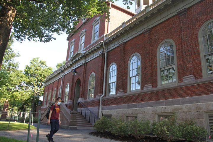 A student walks on the campus of Harvard University in Cambridge, Massachusetts, on July 14, 2020.