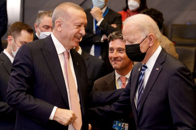US President Joe Biden (R) speaks with Turkey's President Recep Tayyip Erdogan prior to a plenary session...