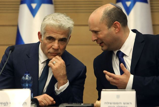 (R to L) Israel's incoming Prime Minister Naftali Bennett and Alternate Prime Minister and Foreign Minister...