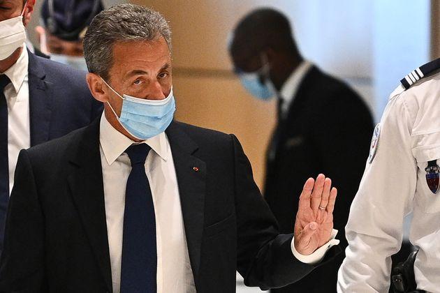 (Photo de Nicolas Sarkozy lors de son procès pour corruption en mars 2021 par Anne-Christine POUJOULAT...