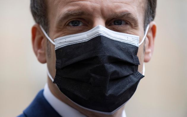 epaselect epa08979615 French President Emmanuel Macron wears a protective face mask as he issues a statement...