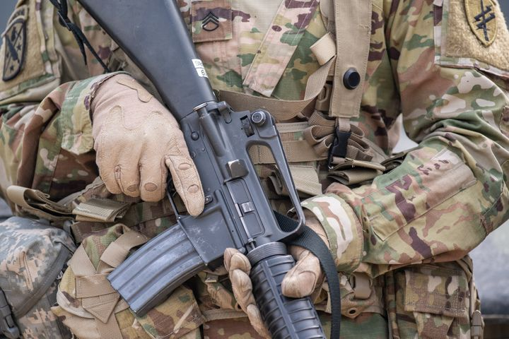 A soldier of the US Army holds his M16 rifle during military exercises in 2019. An investigationhas found that at least