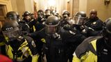 WASHINGTON, DC - JANUARY 06:  Riot police clear the hallway inside the Capitol on Wednesday, Jan. 6, 2021 in Washington, DC. (Kent Nishimura / Los Angeles Times via Getty Images)