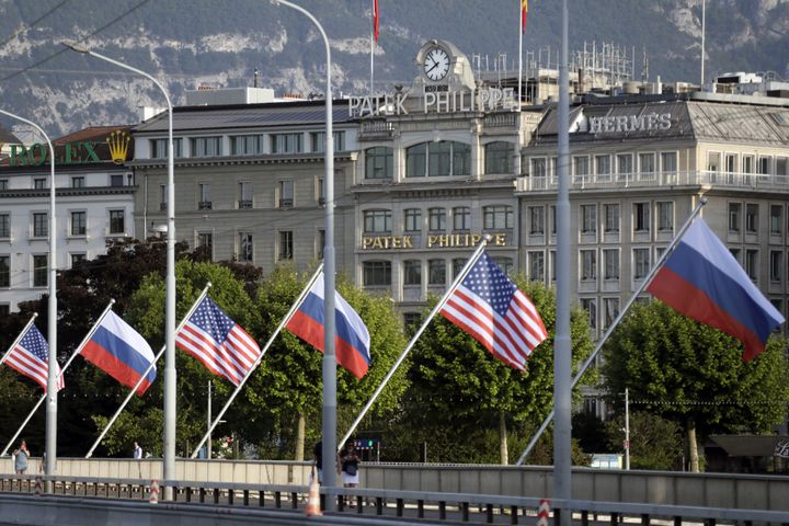 Russian and American flags fly on Mont Blanc Bridge ahead of a meeting scheduled to take place between Putin and Biden.