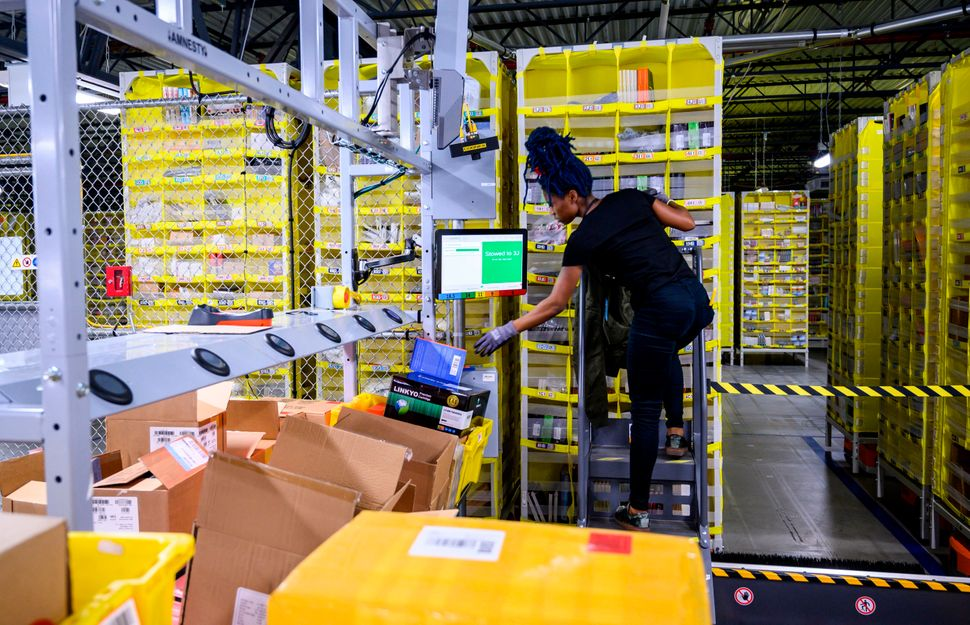 A woman works at a distribution station at the 855,000-square-foot Amazon fulfillment center in Staten Island, New York, in F