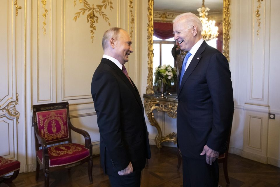 epa09277144 Russian President Vladimir Putin talks with US President Joe Biden after their arrival at...