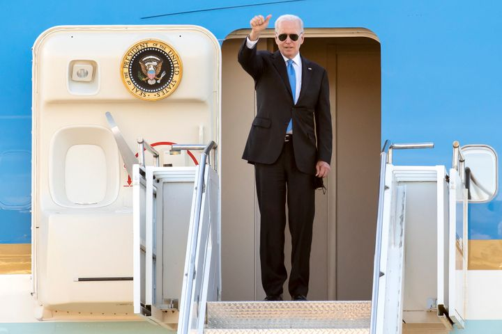 Biden gives a thumbs up before boarding Air Force One after his summit with Putin.