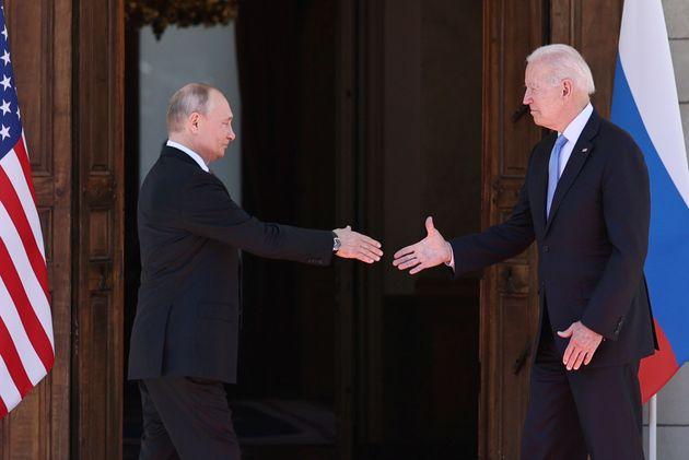 GENEVA, SWITZERLAND JUNE 16, 2021: Russia's President Vladimir Putin (L) and US President Joe Biden shake...