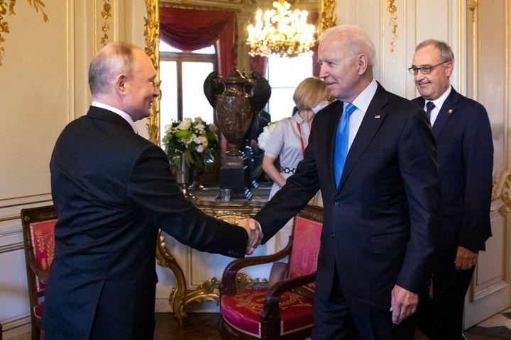 Joe Biden and Vladimir Putin shake hands at their meeting in Geneva.