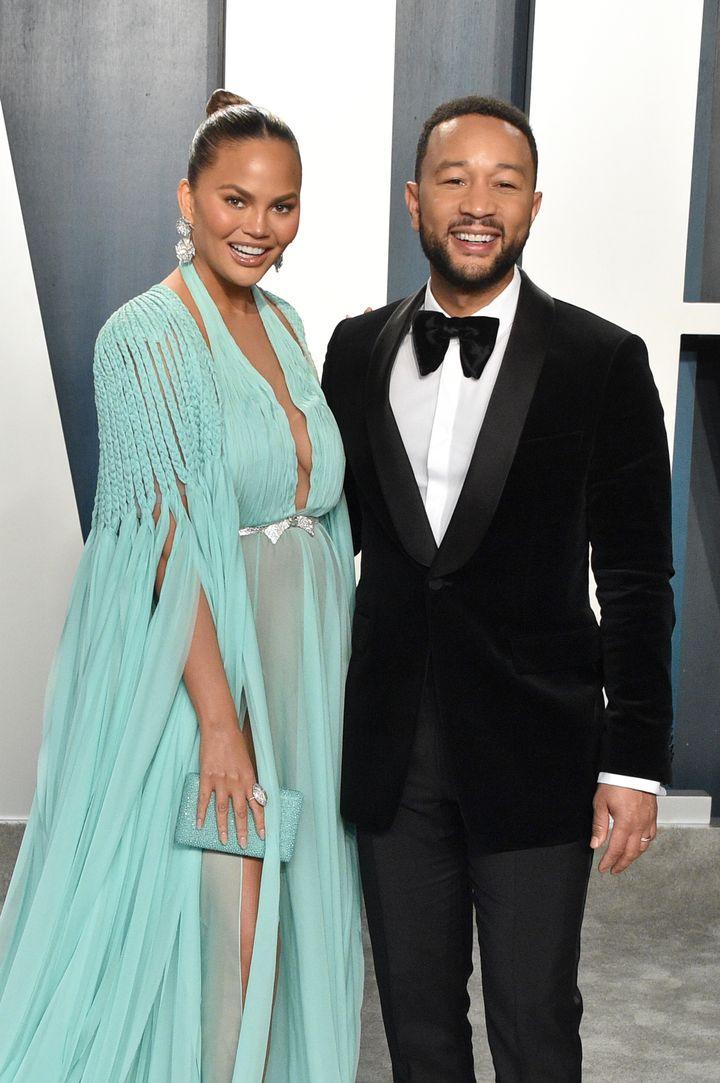 Chrissy Teigen and her husband, John Legend, at the 2020 Vanity Fair Oscar Party.