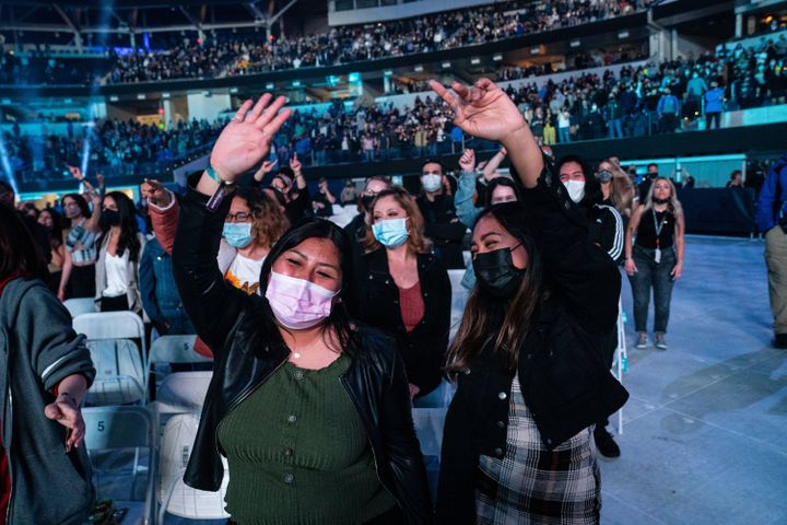Fans enjoy The Foo Fighters performance at the Vax Live concert.