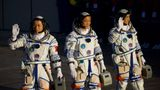 Astronauts (from left to right) Tang Hongbo, Nie Haisheng, and Liu Boming depart for the launch site of the Shenzhou-12 spacecraft at the Jiuquan Satellite Launch Center on June 17, 2021, in Jiuquan, Gansu Province, China.