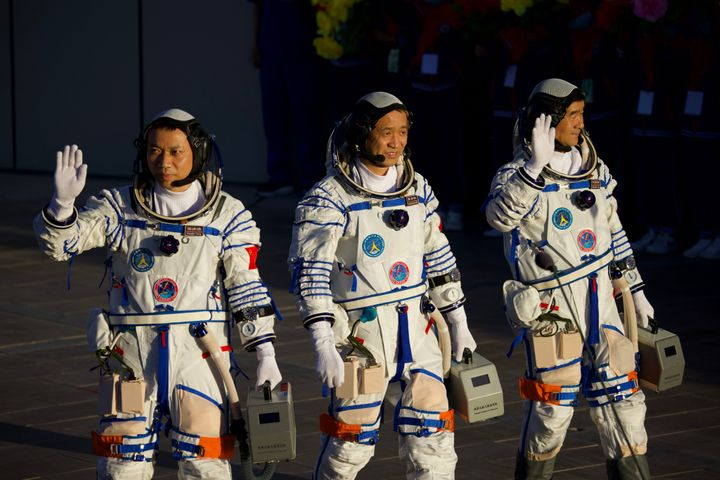 Astronauts (from left to right) Tang Hongbo, Nie Haisheng, and Liu Boming depart for the launch site of the Shenzhou-12 space