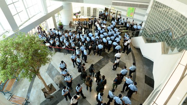 Police officers gather at the headquarters of Apple Daily in Hong Kong, China June 17, 2021. Apple Daily/Handout...
