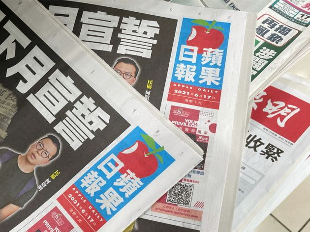 Copies of Next Digital's Apple Daily newspapers are seen at a newsstand in Hong Kong, China June 17,...