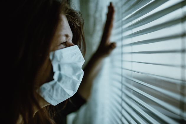 woman in isolation at home for virus