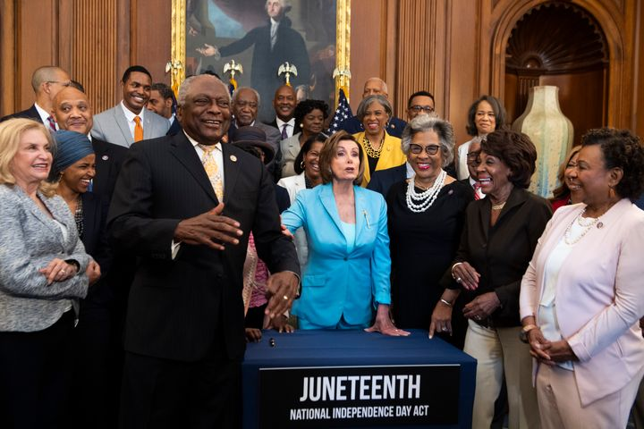 Democrats attend a bill enrollment ceremony for the Juneteenth National Independence Day Act in the Capitol on June 17, 2021.