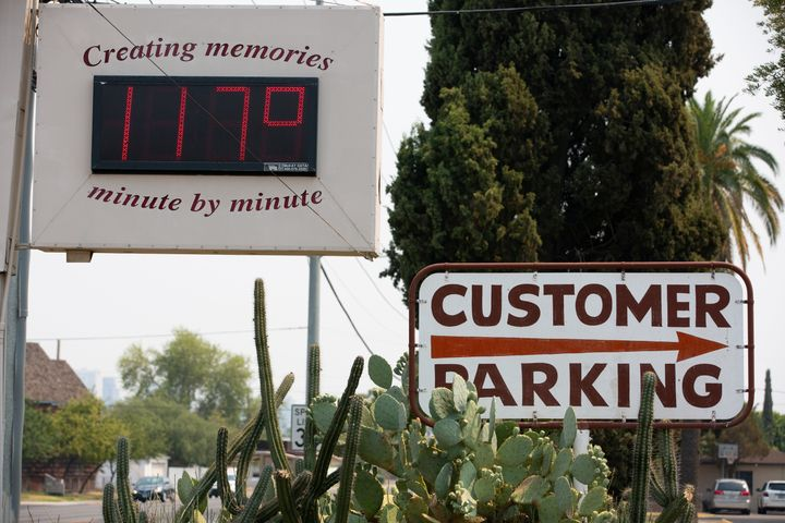 A thermometer sign displays a temperature of 117 degrees Fahrenheit on Tuesday in Phoenix.