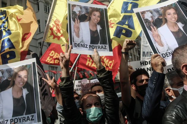 ISTANBUL, TURKEY - 2021/06/17: Protesters hold placards with pictures of Deniz Poyraz, who was killed...