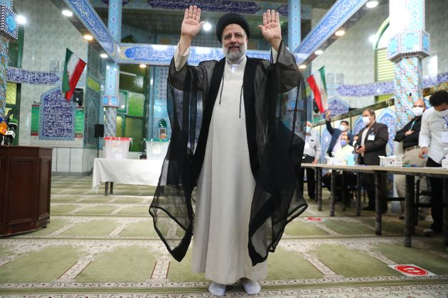 TEHRAN, IRAN - JUNE 18: Iranian ultraconservative cleric and presidential candidate Ebrahim Raisi casts...