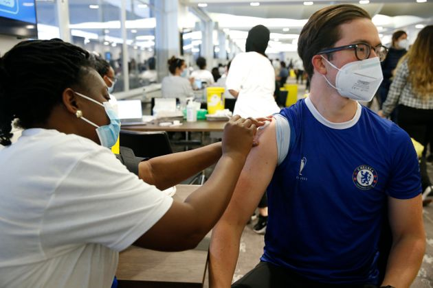LONDON, ENGLAND - JUNE 19: A man receives a vaccine at the Chelsea F.C. pop up vaccine hub on June 19,...