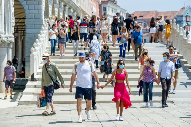 VENICE, ITALY - JUNE 12: Tourists stroll along the basin on June 12, 2021 in Venice, Italy. International...