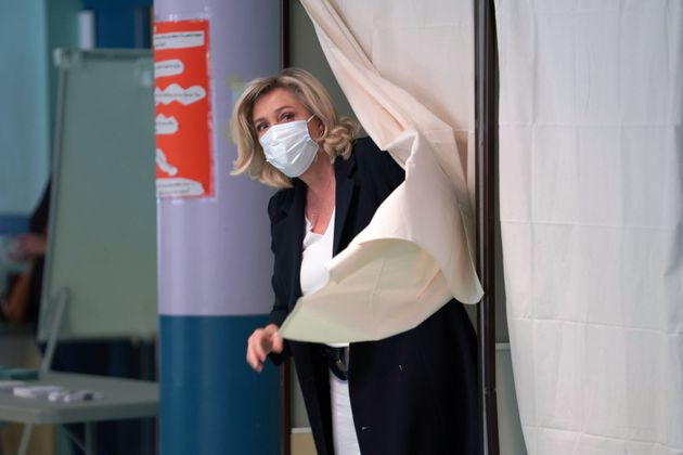 HENIN-BEAUMONT, FRANCE - JUNE 20: French far-right National Rally leader Marine Le Pen leaves a polling...