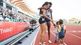 EUGENE, OREGON - JUNE 20: Allyson Felix and Quanera Hayes celebrate with their children after placing second and first respectively in the Women's 400 Meters Final on day three of the 2020 U.S. Olympic Track & Field Team Trials at Hayward Field on June 20, 2021 in Eugene, Oregon. (Photo by Steph Chambers/Getty Images)