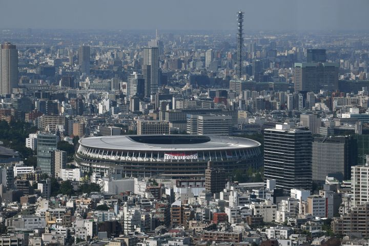 A general view shows the National Stadium (C), the main venue for the 2020 Olympic and Paralympic Games in Tokyo on June 21,