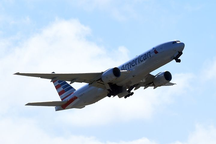 """American Airlines said it's reducing hundreds of its flights through mid-July in hopes of balancing an """"incredibly quick"""" jump in travel demand with a labor shortage and weeks of inclement weather."""