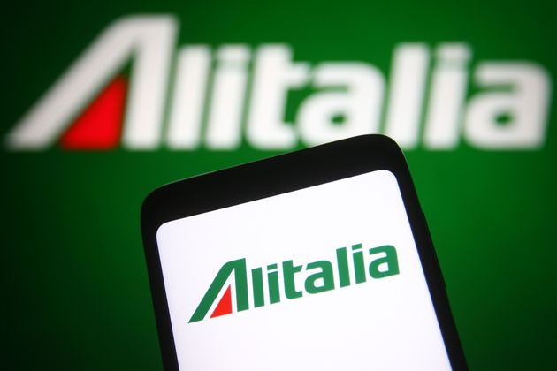 UKRAINE - 2021/06/06: In this photo illustration, an Alitalia logo is seen on a smartphone and a pc screen...