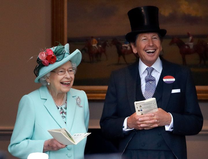 Queen Elizabeth II accompanied by her racing manager John Warren, attends day 5 of Royal Ascot at Ascot Racecourse on June 19