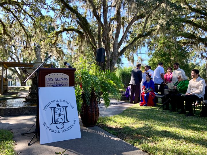 The podium and local dignitaries at the St. Malo marker dedication ceremony.