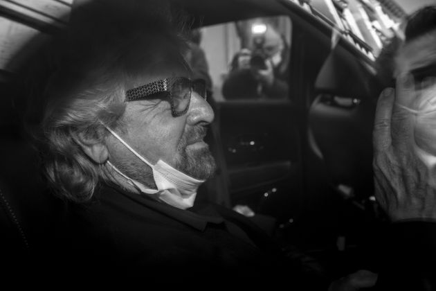 ROME, ITALY - FEBRUARY 6: (EDITOR'S NOTE: Image has been converted to black and white) Beppe Grillo, leader of 5-Stars Movement leaves the Chamber of Deputies following a meeting with the designated Prime Minister Mario Draghi on formation of a new government at the Montecitorio palace, on February , 2021 in Rome, Italy. Designated Prime Minister Mario Draghi has formally accepted the mandate to form a new government following the resignation of Giuseppe Conte. (Photo Antonio Masiello/Getty Images)