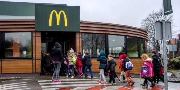 Youngsters enter the McDonald's fast-food outlet on February 26, 2015 in Lille, northern France. Several labour unions and a