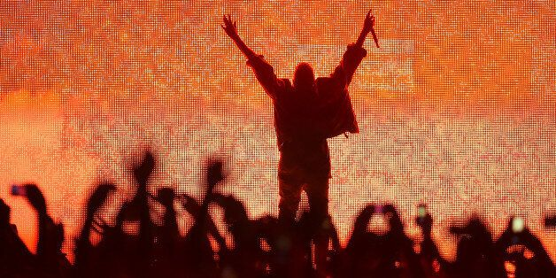 MANCHESTER, TN - JUNE 13:  Artist Kanye West performs at the Bonnaroo Music & Arts Festival on June 13, 2014 in Manchester, T